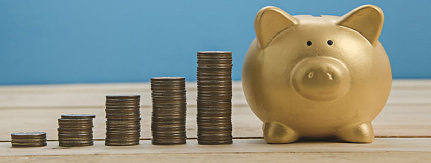 A blue background with a gold piggy bank and stack of coins