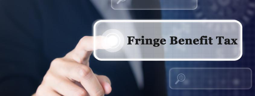 a businessman pressing a fringe benefit tax concept button