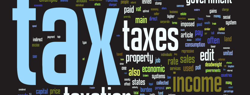 the words tax, taxes, taxation written on a black background