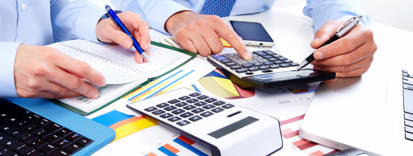 hand with calculator finance and accounting business