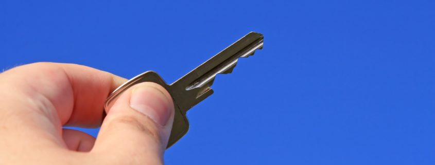 Hand holding a key
