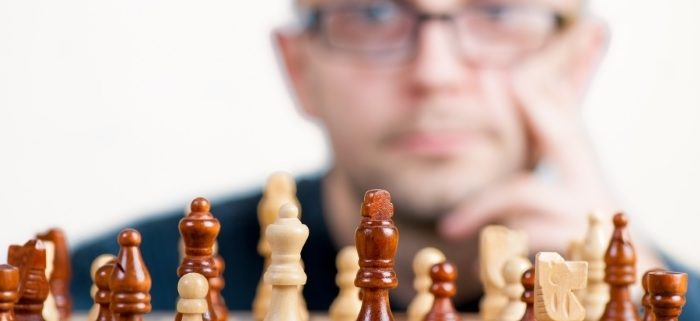 Man critically thinking his next move in playing Chess